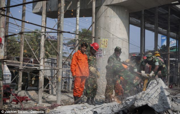 Help: Army personnel joined in the rescue effort after fire crews struggled to reach the scene of the collapse