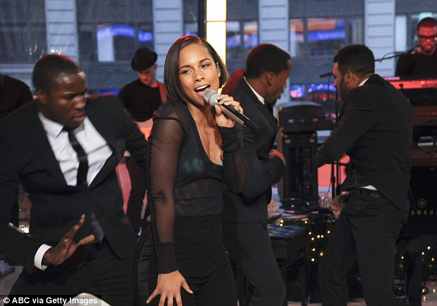 Sheer delight: The 31-year-old singer wore a see-through black shirt over her bra and teamed it with form fitting black trousers.