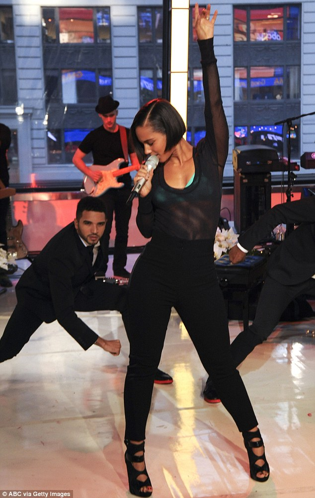 Daring: Alicia Keys performed on Good Morning America on Monday and treated viewers to a raunchy outfit that left her turquoise bra completely visible