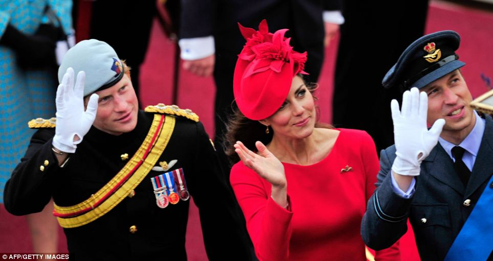 Princes William and Harry and the Duchess of Cambridge wave as they pass the Houses of Parliament aboard the Royal barge during the Thames Diamond Jubilee Pageant
