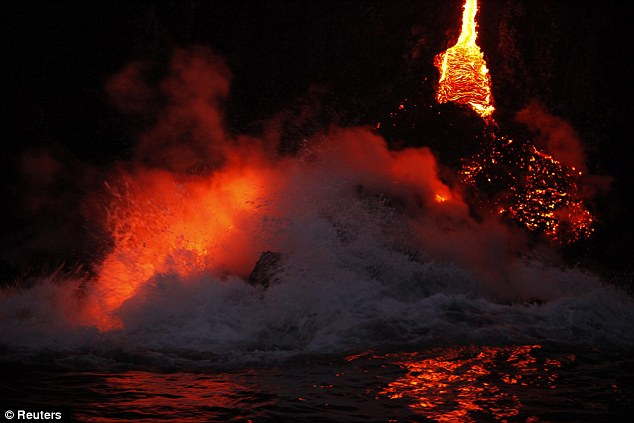 Forces of nature: Waves crash over lava as it flows into the ocean. The hardening lava forms a delta which is unstable and can collapse without warning