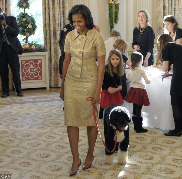 First lady Michelle Obama, accompanied by first dog Bo