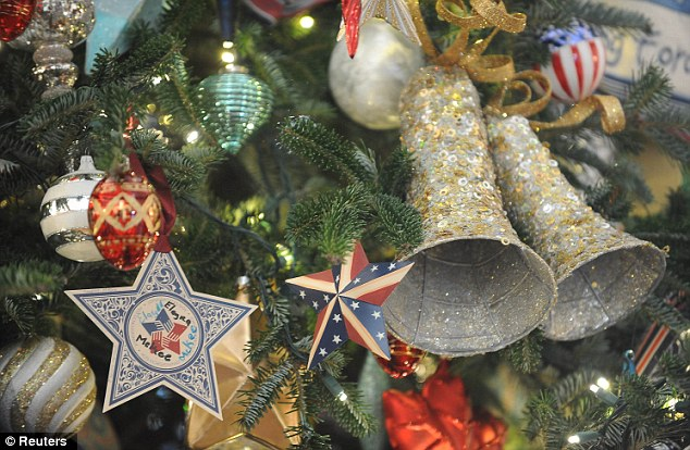 Theatrical edge: A tree festooned with ornaments in the Blue Room at the White House