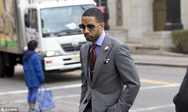 Facing defeat: Ryan Leslie is pictured entering Federal Court in Manhattan, on Wednesday morning before a judge ruled in favor of German auto shop owner Armin Augstein