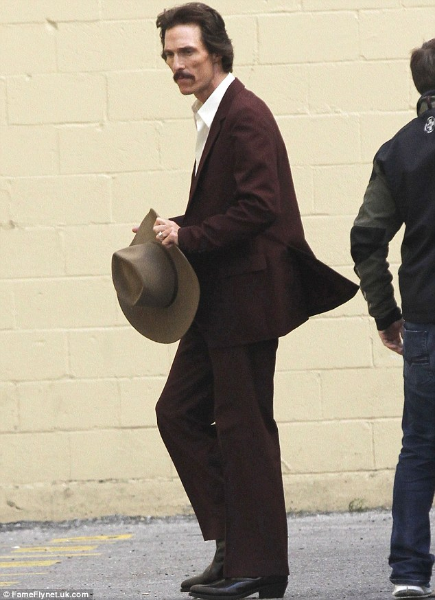 Ever decreasing man: Matthew McConaughey stepped out in a brown suit and cowboy hat, showing off his gaunt frame on the set of The Dallas Buyers Club in New Orleans on Thursday