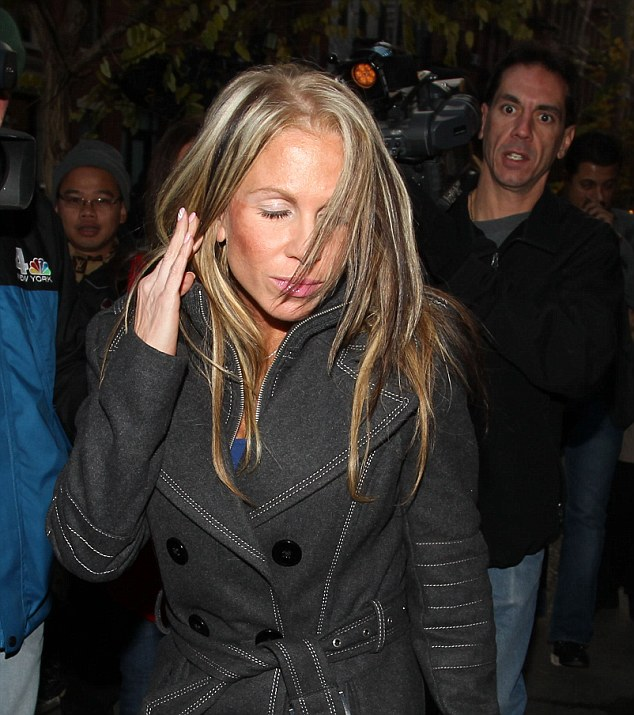 Bruised: One of the women believed to be embroiled in the latest Lindsay Lohan arrest, seen here leaving the 10th Precinct on West 20th street at 7am today