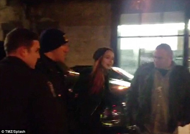 Handcuffs: Lindsay Lohan is led away from Avenue nightclub in handcuffs by police in the early hours of Thursday morning