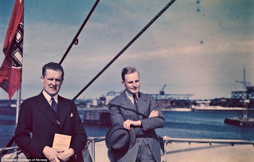 Docking: Two men in suits aboard the steamer Preussen, presumably approaching Germany