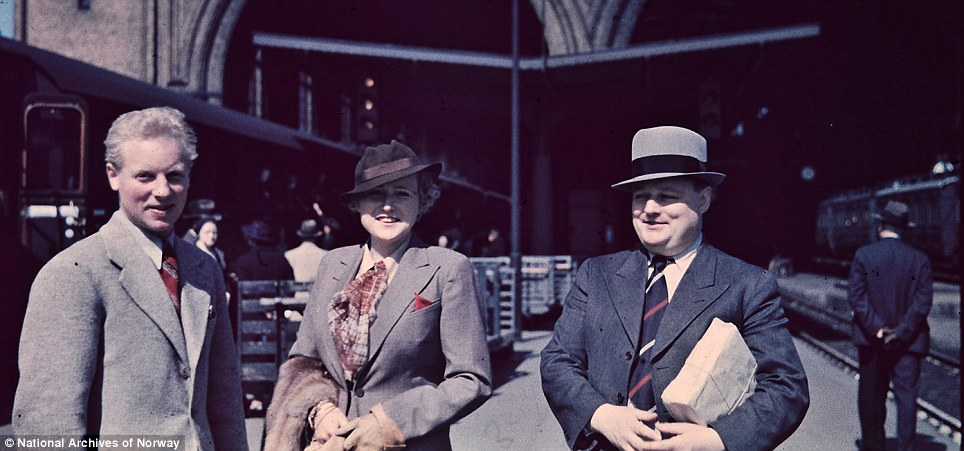 Smiling: An unknown trio at a train station. it is likely they were friends or colleagues of the photographer