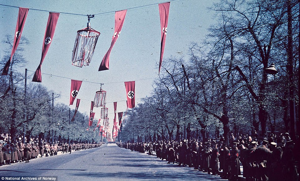 Order: This intimidating picture shows troops lining a boulevard festooned with swastikas in anticipation of a parade
