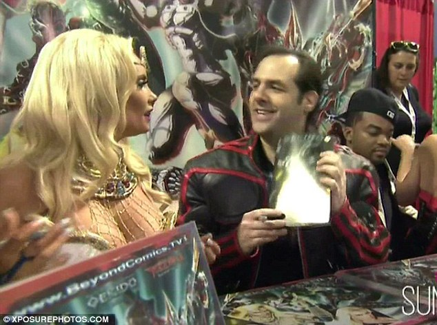 Happy fans: The busty blonde also signed autographs and promoted the comic book she's featured in