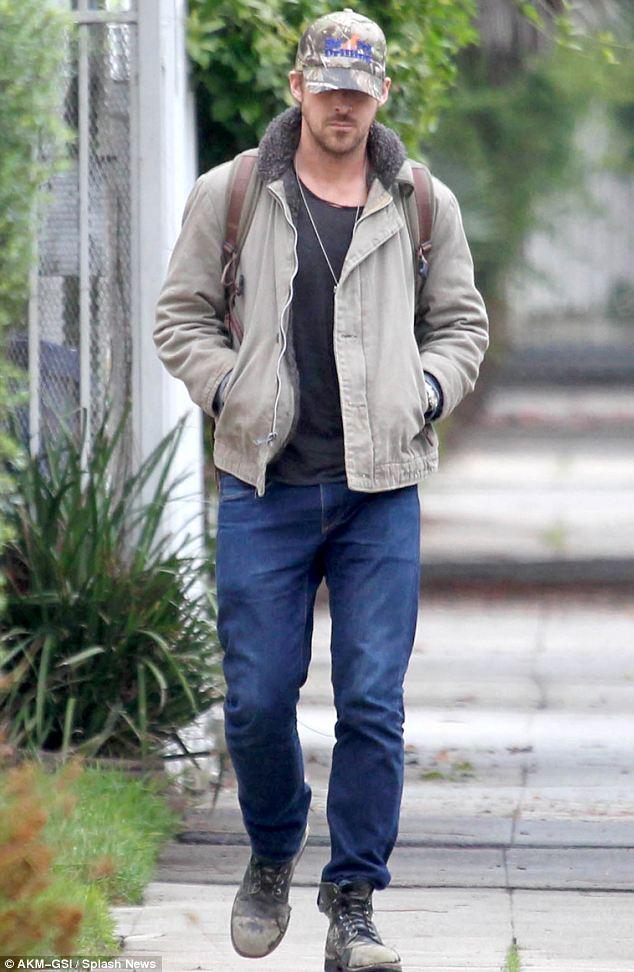 Casual: Ryan kept it low-key wearing jeans, baseball cap and jacket