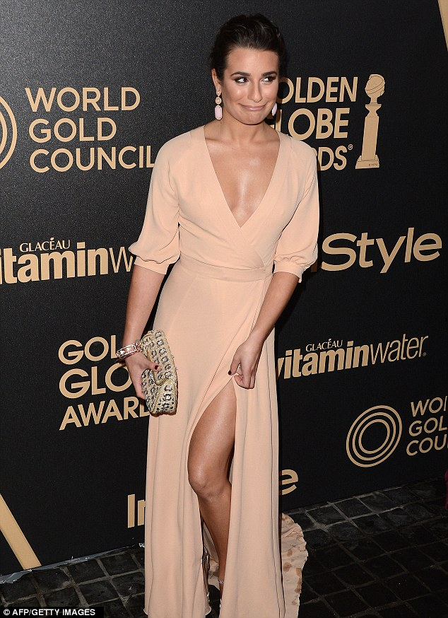Sultry: Lea Michele shows off her saucy side in a low cut nude dress with a split up the side