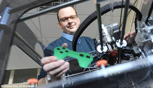 Breakthrough: Warwick University's Dr Simon Leigh holds a video games controller he and his team 3D printed using a new material that is both conductive and piezo-resistive