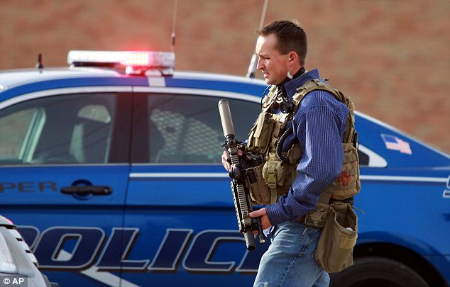 On Duty: Police officers responded in full tactical gear to the campus attack at Casper College.