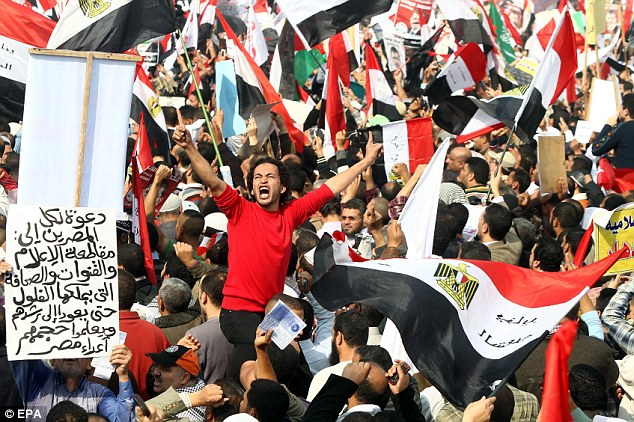 Egyptian supporters of Muslim Brotherhood taking part in a demonstration near Cairo University, in Cairo, in support of President Mohamed Morsi's recent constitutional declaration