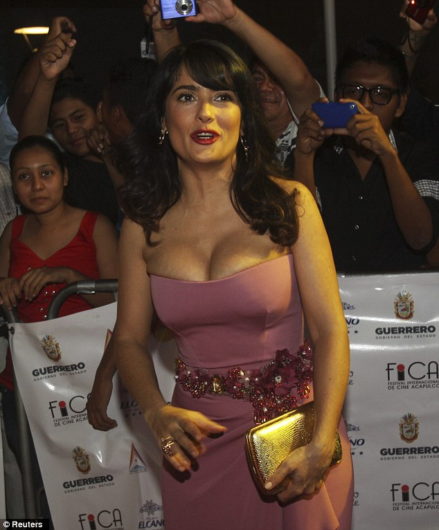 Figure-hugging: Salma certainly stands out from the crowd in her curve-enhancing red carpet gown