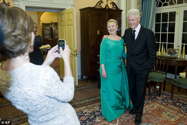 Snap: Former President Bill Clinton and Secretary of State Hillary Rodham Clinton pose for a photo after the State Department Dinner for the Kennedy Center Honors gala on Saturday