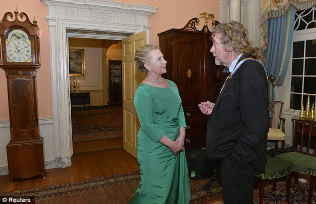 Rock legend: U.S. Secretary of State Hillary Clinton chats with Kennedy Center 2012 Honoree Robert Plant from the rock band Led Zeppelin