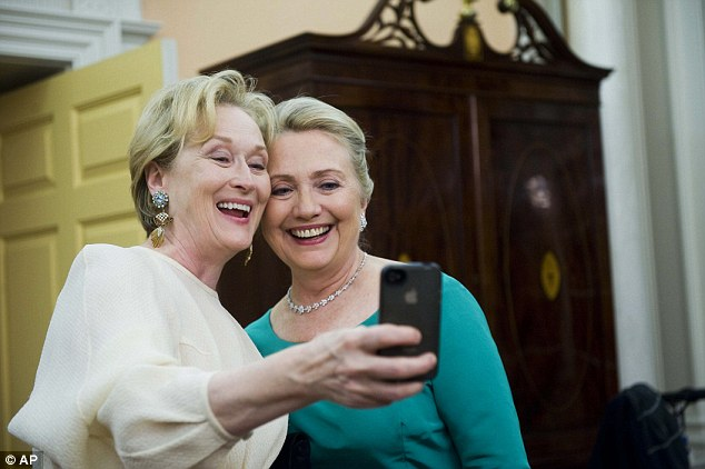 Say cheese: Actress Meryl Streep uses her iPhone to get a photo of her and Secretary of State Hillary Clinton following the State Department Dinner for the Kennedy Center Honors gala