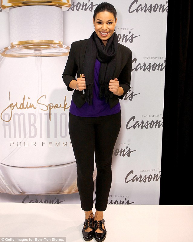 Ready for business: The singer-turned-actress wrapped up in a black trousers and a cropped jacket with a scarf