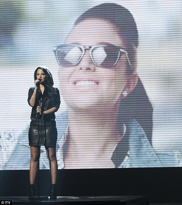 Feeling the strain: Tulisa was visibly nervous during and after her performance