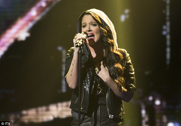 Back to life: Tulisa performed in a hoodie as she sang her new song Sight Of You on the X Factor on Saturday night