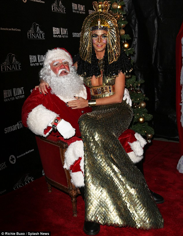Just like old times: Both Heidi and Santa seemed to be enjoying bouncing her on his knee