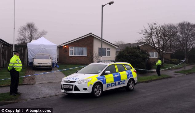 Search: Officers discovered Mrs Johnson's body in what is believed to be their bungalow's front garden and her 58-year-old husband's body in a nearby back garden