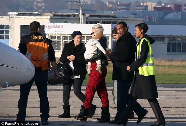 Frequent flyer: P!nk left Paris carrying her baby as she boarded a private jet to get to London