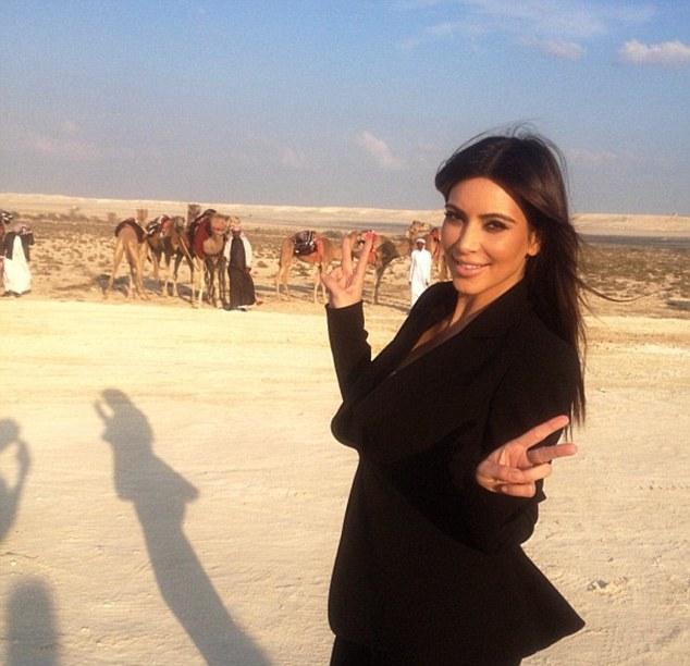 Enjoying her trip: Kim poses in the desert