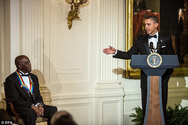 Praise: Obama spoke highly of bluesman Buddy Guy, left, who came from a humble background