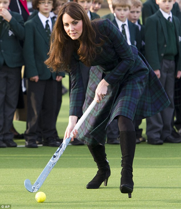 Good sport: In this photo from last Friday the Duchess of Cambridge, plays hockey during her visit to St. Andrew's School, where she attended school from 1986 till 1995, in Pangbourne