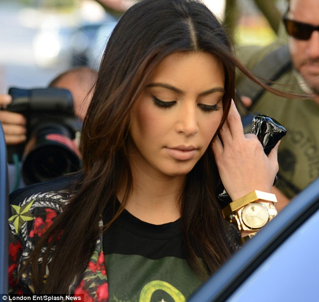 Expertly made up: There was no hint of bad skin under Kim's thick war paint