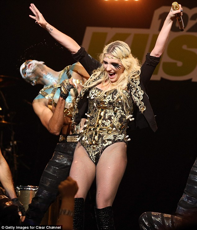 Put your hands up: Ke$ha enjoyed every minute of her time on stage with her dancers