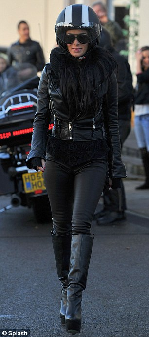 The wild one: Nicole looked super cool and extremely sultry in her set of leather boots and matching jacket and trousers