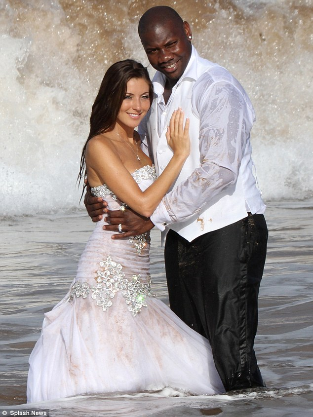 sdfTaking the plunge: Newlyweds Ryan Howard and Krystle Campbell decided to trash their wedding attire in the Pacific Ocean in Hawaii