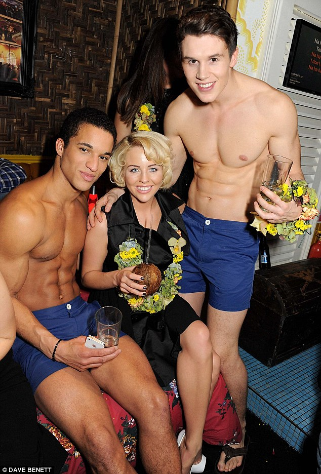 What would Tom say? Lydia Bright grinned from ear to ear as she posed up to the scantily clad models at the bash
