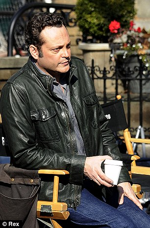 Gigantic proportions: Vince Vaughn towers above his PA on the set of The Delivery Man in New York City