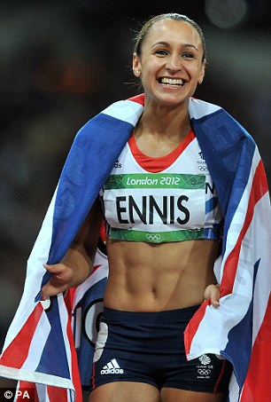 Work clothes: Ennis celebrates after winning gold in the women's heptathlon at the Olympic Stadium