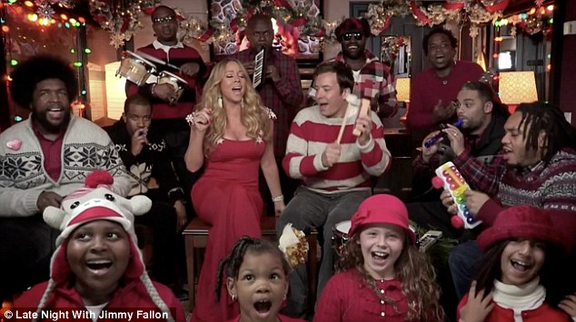 Festive fun: Mariah Carey gave All I Want For Christmas Is You a new twist as she performed on Late Night With Jimmy Fallon
