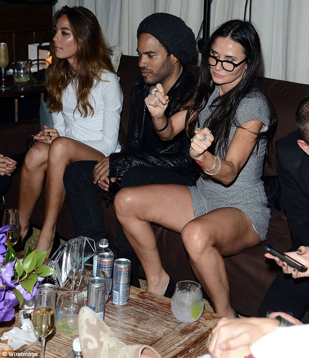 Dancing Demi: Ms Moore displayed some very bizarre behaviour as she partied with friends including Lenny Kravitz at the Chanel Beachside Barbecue on Wednesday night