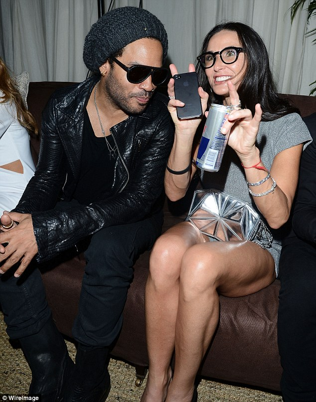 Ready to party: Demi clutched a can of energy drink as she made the most of the evening