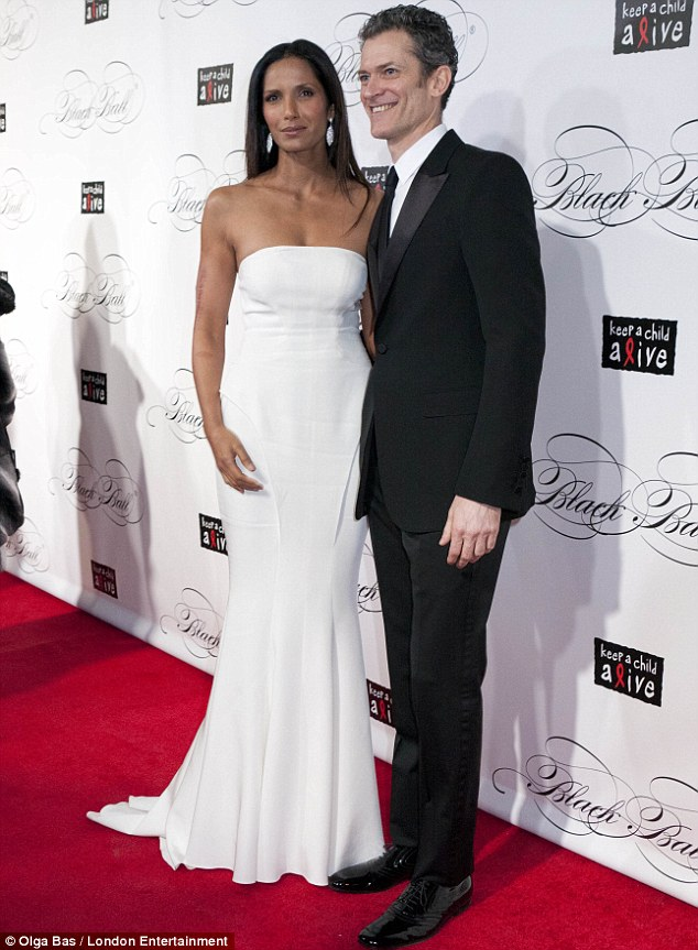 No wonder he's smiling: Jolly Peter Twyman could not believe his luck as he posed with stunning Padma Lakshmi