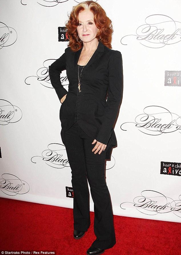 Bonnie lass: Music star Raitt looked surprisingly good in this black trouser suit