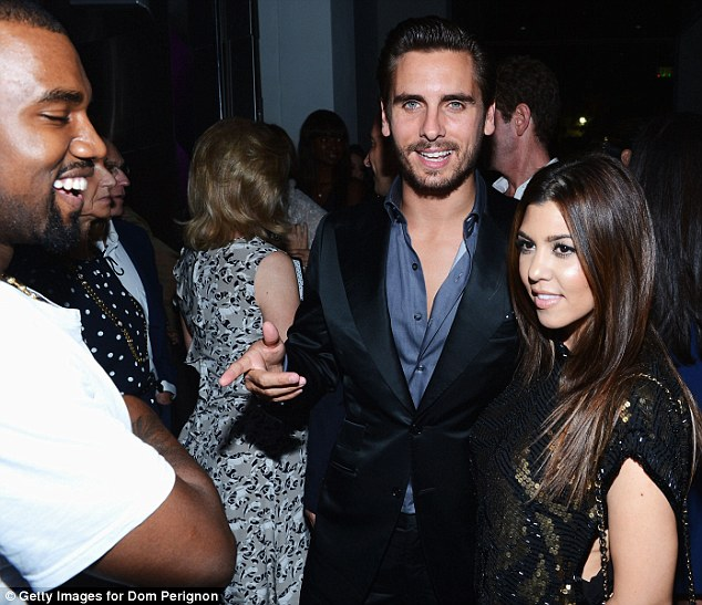 We are family: Kanye (right) with Scott Disick and Kim's sister Kourtney