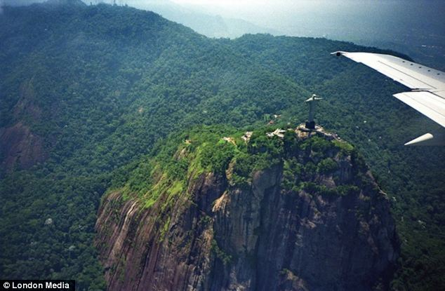 Famous landmark: Yvon Maurice took this photo from a cabin as she flew over Christ the Redeemer in Rio de Janeiro, Brazil