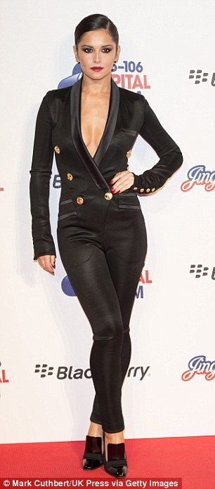 Not afraid to show off her figure: A satin jumpsuit is a hard fashion item to pull off, but Cheryl is up for the task
