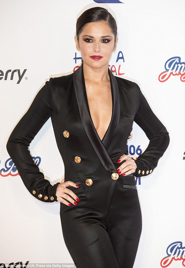 Belle of the ball! Cheryl made sure the spotlight was on her in the revealing black satin jumpsuit