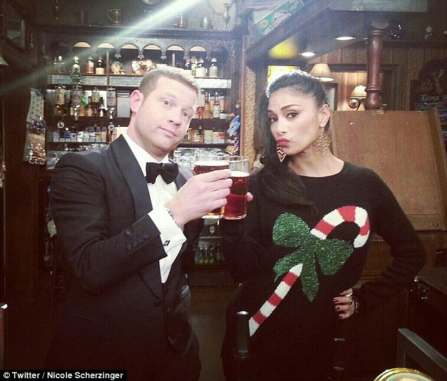 Pout: Just another day at the office for Nicole and Dermot